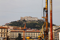 Napoli: In a colorful photo, a view of the Vomero hill, where is located the ancient Castel Sant'Elmo, with the white buildings of the Certosa and of the Saint Martino museum in front. The photo was taken from a nord part of the town center, near the see, and it includes some cranes. Digitally Improved Photo.