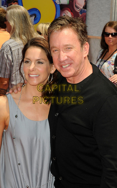 "JANE HAJDUK & TIM ALLEN .at the world premiere of World Premiere of Disney Pixar's ""Toy Story 3"" at El Capitan Theatre in Hollywood, California, USA, June 13th, 2010. .half length grey gray sleeveless silver necklace married wife husband black CAP/ROT.©Lee Roth/Capital Pictures"