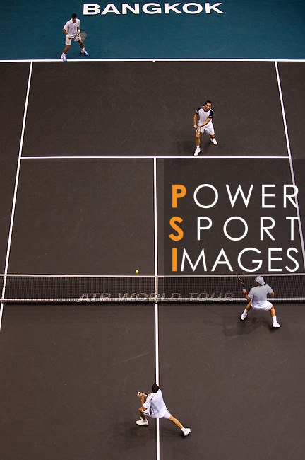 BANGKOK, THAILAND - OCTOBER 03:  Viktor Troicki of Serbia and Christopher Kas of Germany in action on their doubles match against Jonathan Erlich of Israel and Jurgen Melzer of Austria during the Day 9 of the PTT Thailand Open at Impact Arena on October 3, 2010 in Bangkok, Thailand. Photo by Victor Fraile / The Power of Sport Images