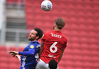 4th July 2020; Ashton Gate Stadium, Bristol, England; English Football League Championship Football, Bristol City versus Cardiff City; Nathan Baker of Bristol City competes in the air with Sean Morrison of Cardiff City