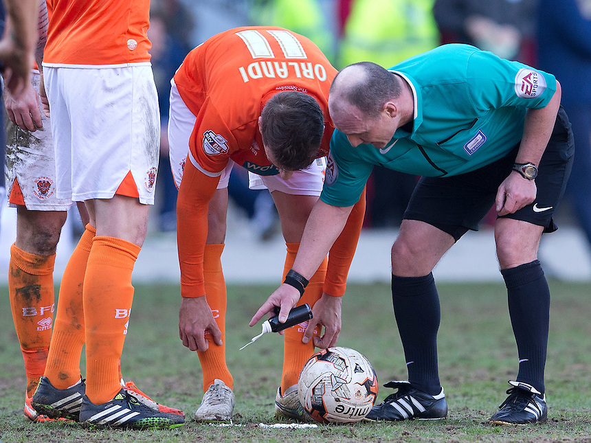 Referee Scott Duncan marks out the spot for the ball at a free kick watched by Blackpool's Andrea Orlandi<br /> <br /> Photographer Stephen White/CameraSport<br /> <br /> Football - The Football League Sky Bet Championship - Blackpool v Leeds United - Saturday 21st March 2015 - Bloomfield Road - Blackpool<br /> <br /> &copy; CameraSport - 43 Linden Ave. Countesthorpe. Leicester. England. LE8 5PG - Tel: +44 (0) 116 277 4147 - admin@camerasport.com - www.camerasport.com