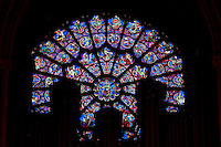 Low angle view of the west rose window with silhouette of the organ in the foreground on November 23, 2008 in Notre Dame de Paris, Ile de la Cité, Paris, France. The west rose window dates back circa 1220 and features symbolic scenes of the zodiacs and labors of the months. The cathedral was initiated by the bishop Maurice de Sully and built between 1163 and 1345. Picture by Manuel Cohen