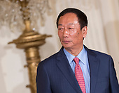 Foxconn CEO Terry Gou listens during the announcement of the creation of a Foxconn Factory to be built in Wisconsin to build LCD flat screen monitors at The White House in Washington, DC, July 26, 2017.  <br /> Credit: Chris Kleponis / CNP