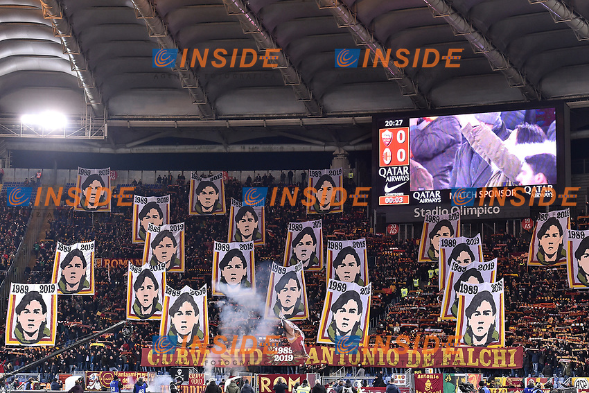 AS Roma suppporters cheer on showing banners with the portrait of Antonio De Falchi, a supporter died in 1989 in Milano, ahead the Serie A 2018/2019 football match between AS Roma and AC Milan at stadio Olimpico, Roma, February 3, 2019 <br />  Foto Andrea Staccioli / Insidefoto