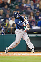 Leon Byrd #1 of the Rice Owls makes contact with the baseball against the Texas Longhorns at Minute Maid Park on February 28, 2014 in Houston, Texas.  The Longhorns defeated the Owls 2-0.  (Brian Westerholt/Four Seam Images)