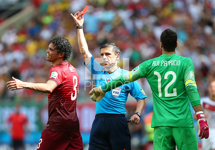 Pepe of Portgual is shown a red card for a headbutt on Thomas Muller of Germany