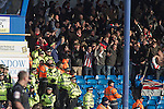 "Portsmouth 1 Southampton 1, 18/12/2012. Fratton Park, Championship. Visiting Southampton fans reacting with delight as their team take the lead during the second half of their Championship fixture against Portsmouth at Fratton Park stadium. Around 3000 away fans were taken directly to the game in a fleet of buses in a police operation known as the ""coach bubble"" to avoid the possibility of disorder between rival fans. The match ended in a one-all draw watched by a near capacity crowd of 19,879. Photo by Colin McPherson."