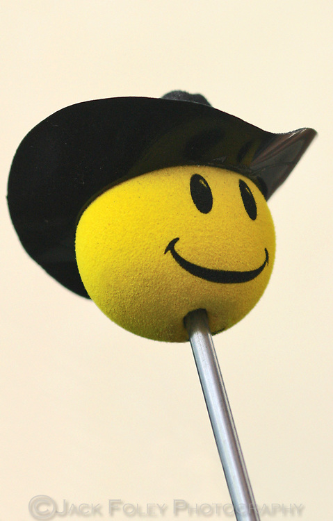Happy face toy with cowboy hat.