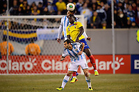Ecuador forward Felipe Caicedo (8) goes up for a header with Argentina midfielder Javier Mascherano (14) and defender Ezequiel Garay (2). Argentina and Ecuador played to a 0-0 tie during an international friendly at MetLife Stadium in East Rutherford, NJ, on November 15, 2013.