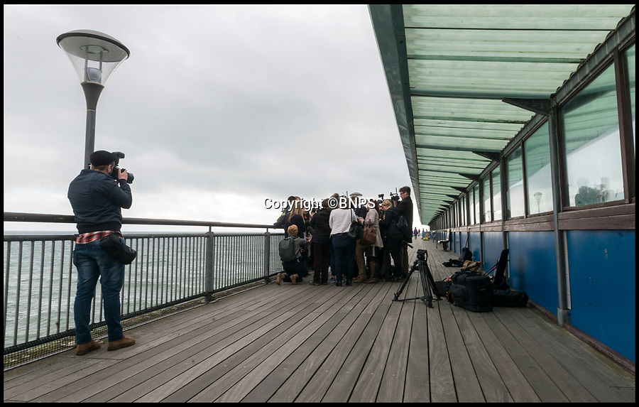 BNPS.co.uk (01202 558833)<br /> Pic: LeeMcLean/BNPS<br /> <br /> Sam back on Boscombe Pier today with hero paramedic Matt Harrison.<br /> <br /> The angler who 'died' for three minutes when he accidentally swallowed a fish he had caught today told how he thought he had had his chips.<br /> <br /> Sam Quilliam, 28, dangled the Dover sole over his mouth and went to kiss it as a joke when it slipped from his fingers and jumped down his throat.<br /> <br /> It blocked his airway and sent him into cardiac arrest, causing him to stop breathing for three minutes.<br /> <br /> Fisherman friends Steve Perry and Matt Holmes saved his life by giving him CPR before an ambulance paramedic used forceps to yank the flat fish out of the back of Sam's throat.<br /> <br /> Sam today returned to Boscombe Pier in Bournemouth to thank his friends and paremedics.