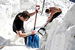 Kevin Schott, left, and Alexander Jimenez, right, work to dig out a propane tank buried under record early season snowfall in Soda Springs, Calif., January 6, 2011. California has already received 80% of its normal annual precipitation in the first two months of a rainy season that lasts another four months..CREDIT: Max Whittaker for The Wall Street Journal.CALWATER