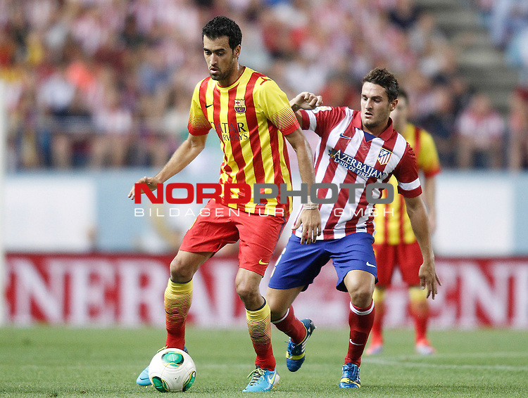 Atletico de Madrid's Koke (r) and FC Barcelona's Sergio Busquets during Supercup of Spain 1st match.August 21,2013. Foto © nph / Acero)