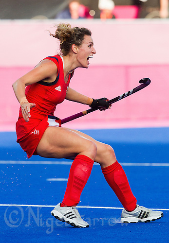 02 AUG 2012 - LONDON, GBR - Ashleigh Ball (GBR) of Great Britain celebrates scoring the first goal of the teams 3-0 win against Belgium in their London 2012 Olympic Games preliminary round hockey match at the Riverbank Arena in the Olympic Park at Stratford, Great Britain (PHOTO (C) 2012 NIGEL FARROW)