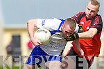 Gary Sayers of Keel is held back by Tarbert's Jason Wrenn last Sunday afternoon in Shannon Park, Tarbert.
