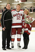 Keith Moore, Colin Moore (Harvard - 12), Lisa Moore - The Harvard University Crimson defeated the visiting Clarkson University Golden Knights 3-2 on Harvard's senior night on Saturday, February 25, 2012, at Bright Hockey Center in Cambridge, Massachusetts.