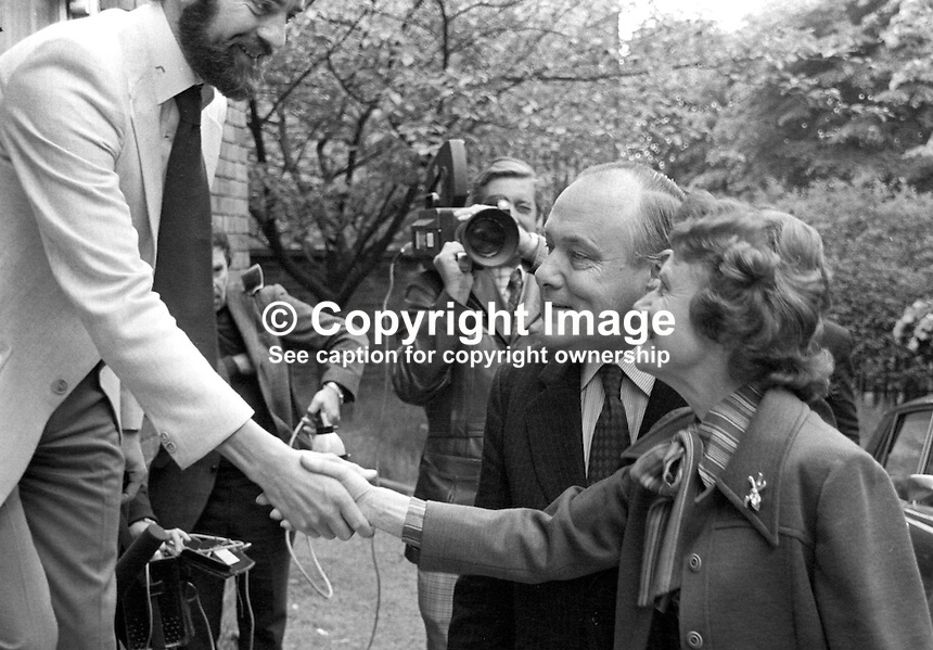 New Zealand Prime Minister Robert Muldoon, accompanied by his wife Thea Muldoon, is welcomed by Ciaran McKeown, of the Peace People in Belfast during a two day visit to N Ireland.  197706190207d.<br />