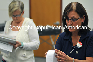 MIDDDLEBURY, CT 08 NOVEMBER 2011--110811JS11---Election moderator Marilee Dabkowski, right, reads of the final numbers in the municipal election for the Town of Middlebury Tuesday at the Shepardson Community Center in Middlebury as fellow moderator Betty Prouix, left, copies the numbers. <br /> Jim Shannon Republican-American