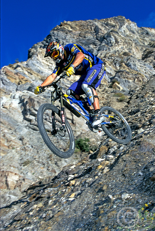 Steve Peat riding down rocky slope , GT bike , nr Orgiva, Spain . November 2000.pic copyright Steve Behr / Stockfile