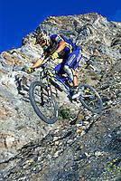 Steve Peat riding down rocky slope , GT bike , nr Orgiva, Spain . November 2000.pic copyright Steve Behr / Stockfile