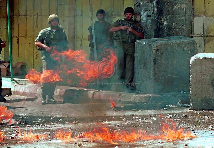 Clashes in downtown Hebron West Bank, October 2000. Photo by Quique Kierszenbaum