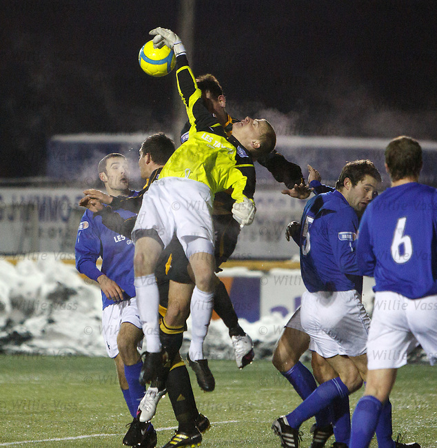 Peterhead keeper Jon Bateman makes a series of saves in the dying seconds to rescue his side