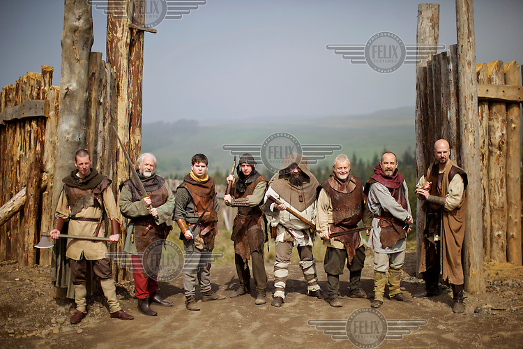 Members of Charles John Allan's clan (Clanranald) of 250 people.. recreating medieval history at Duncarron Fort near Denny.  Charles (or 'Chick') counts Russell Crowe among his friends having acted in numerous Hollywood blockbusters including Gladiator and Robin Hood. For over 16 years he has used around GBP 650,000, earned from movies, to construct his fort with the aim of educating his fellow Scot's about the overlooked aspects of their national history and in the process has brought together volunteers, ex-convicts and history buffs to be part of the growing family...