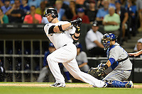 Chicago White Sox catcher Tyler Flowers (21) at bat in front of catcher Dioner Navarro (30) during a game against the Toronto Blue Jays on August 15, 2014 at U.S. Cellular Field in Chicago, Illinois.  Chicago defeated Toronto 11-5.  (Mike Janes/Four Seam Images)