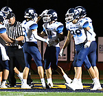 Mater Dei running back Zach Napovanice (11, at center) is congratulated by teammates after running in a touchdown. Mater Dei played football at Althoff on Friday September 13, 2019. <br /> Tim Vizer/Special to STLhighschoolsports.com