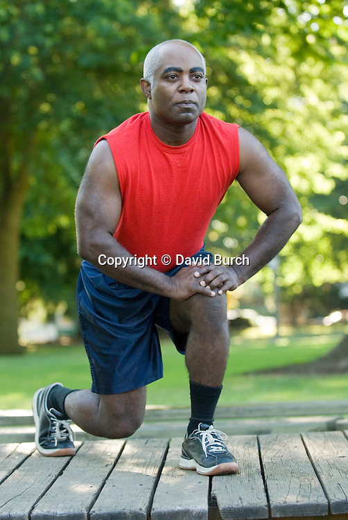 Mature man exercising, front view