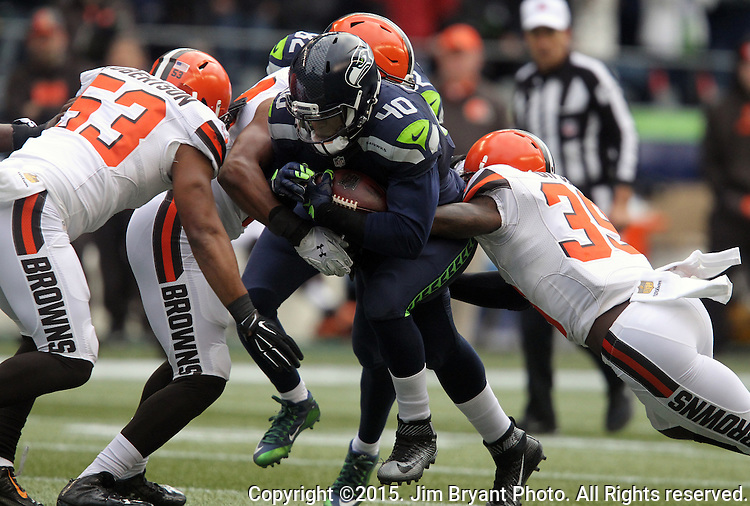 Seattle Seahawks fullback Derrick Coleman (40) runs against the Cleveland Browns linebacker Craig Robertson (53) and defensive back Tashaun Gipson (39) at CenturyLink Field in Seattle, Washington on December 20, 2015. The Seahawks clinched their fourth straight playoff berth in four seasons by beating the Browns 30-13.  ©2015. Jim Bryant Photo. All Rights Reserved.