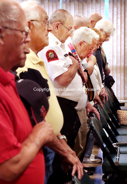 TORRINGTON CT. 27 July 2017-072717SV11-Veterans bow their head in prayer during the Anniversary of the Korean War Armistice ceremony in Torrington Thursday.<br /> Steven Valenti Republican-American