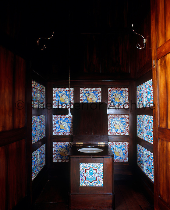 The wood panelled 'thunderbox' and walls of the loo are inlaid with tiles with Japanese and Islamic patterns