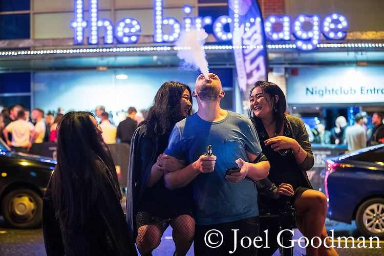 "© Joel Goodman - 07973 332324 . 17/12/2016 . Manchester , UK . Revellers outside the Birdcage in Manchester City Centre overnight during "" Mad Friday "" , named for being one of the busiest nights of the year for the emergency services in the UK . Photo credit : Joel Goodman"
