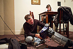 Steve McFarland fixes the vacuum while his daughter does homework on Tuesday, December 6, 2011 in Webster City, IA.