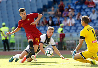 Calcio, Serie A: Roma vs Udinese. Roma, stadio Olimpico, 23 settembre 2017.<br /> Roma&rsquo;s Stephan El Shaarawy, left, kicks the ball to score a goal as Udinese&rsquo;s goalkeeper Albano Bizzarri, right, and Jens Larsen try to stop him during the Italian Serie A football match between Roma and Udinese at Rome's Olympic stadium, 23 September 2017. Roma won 3-1.<br /> UPDATE IMAGES PRESS/Riccardo De Luca