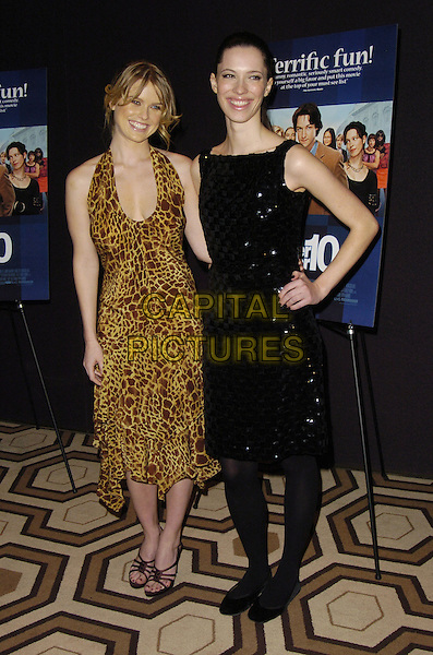 """ALICE EVE & REBECCA HALL.Special New York Screening of """"Starter For 10"""" at Tribeca Grand Screening Room, New York, New York, USA..February 13th, 2007.full length dress black hand on hip yellow leopard animal print .CAP/ADM/BL.©Bill Lyons/AdMedia/Capital Pictures *** Local Caption ***"""