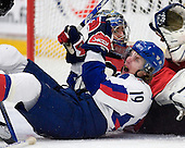 Julius Sinkovic (Val-d'Or - Slovakia) falls into Reto Berra (GCK Lions Zurich - Switzerland). The Suisse defeated Slovakia 2-1 in a 2007 World Juniors match on January 2, 2007, at FM Mattson Arena in Mora, Sweden.