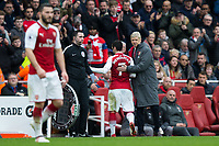 Arsenal's Henrikh Mkhitaryan gets a pat on the back from Arsenal manager Arsene Wenger after he is substituted off <br /> <br /> Photographer Craig Mercer/CameraSport<br /> <br /> The Premier League - Sunday 11th March 2018 - Arsenal v Watford - The Emirates - London<br /> <br /> World Copyright &copy; 2018 CameraSport. All rights reserved. 43 Linden Ave. Countesthorpe. Leicester. England. LE8 5PG - Tel: +44 (0) 116 277 4147 - admin@camerasport.com - www.camerasport.com
