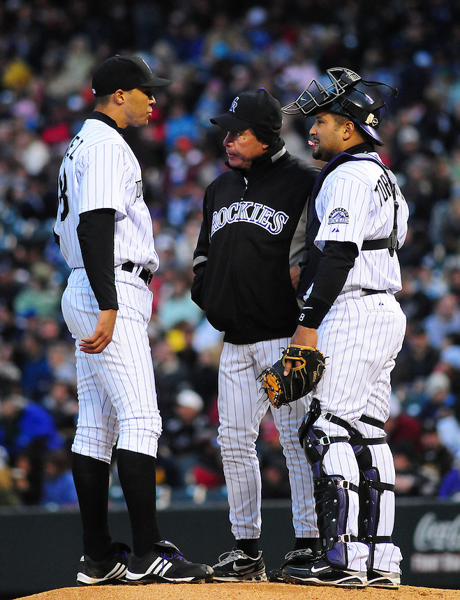 25 April 2009: Rockies pitching coach Bob Apodaca and catcher Yorvit Torrealba have a word with pitcher Ubaldo Jimenez during a game between the Los Angeles Dodgers and the Colorado Rockies at Coors Field in Denver, Colorado. *****For Editorial Use Only*****