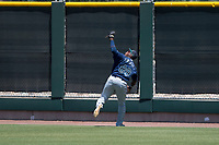 Seattle Mariners right fielder Jose Sandoval (89) pursues a fly ball during an Extended Spring Training game against the San Francisco Giants Orange at the San Francisco Giants Training Complex on May 28, 2018 in Scottsdale, Arizona. (Zachary Lucy/Four Seam Images)