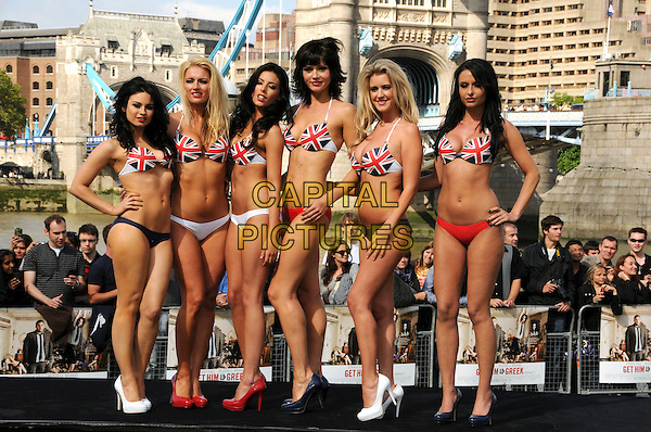"""MODELS .At a photocall for """"Get Him To The Greek"""", Tower Bridge, London, England, UK, June 20th 2010..full length bikini clad girls  union jack flags bikini top red white blue shoes heels .CAP/CAS.©Bob Cass/Capital Pictures."""