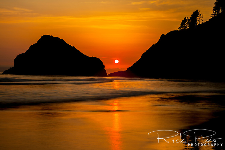 Sunset reflects on the beach at Haceta Head on Oregon's Central Coast