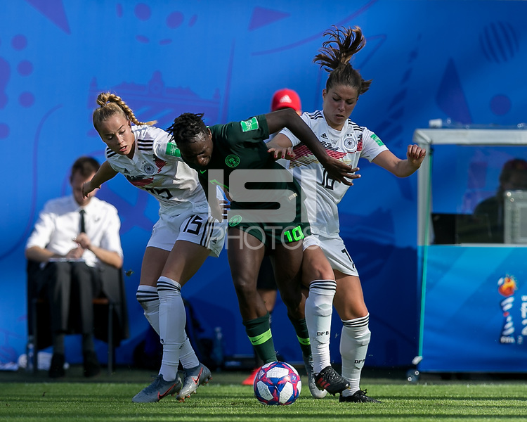 GRENOBLE, FRANCE - JUNE 22: Chinwendu Ihezuo #19 of the Nigerian National Team attempts to control the ball as Giulia Gwinn #15 of the German National Team and Melanie Leupolz #18 of the German National Team defend during a game between Panama and Guyana at Stade des Alpes on June 22, 2019 in Grenoble, France.
