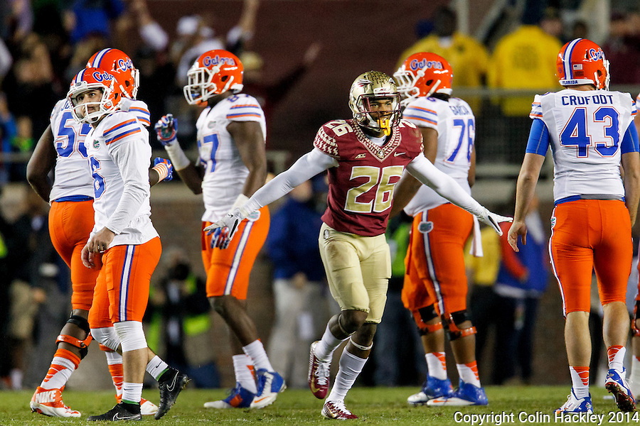 TALLAHASSEE, FL 11/29/14 FSU-UF112914-Florida State's P.J. Williams signals no good as  University of Florida's kicker Austin Hardin, left, reacts as he misses a 42-yard field goal attempt during fourth quarter action Saturday at Doak Campbell Stadium in Tallahassee. The Seminoles beat the Gators 24-19.<br /> COLIN HACKLEY PHOTO