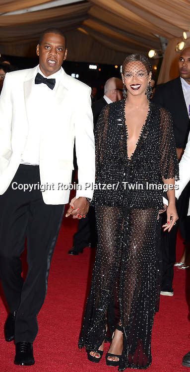 Jay-Z and Beyonce Knowles attend the Costume Institute Benefit on May 5, 2014 at the Metropolitan Museum of Art in New York City, NY, USA. The gala celebrated the opening of Charles James: Beyond Fashion and the new Anna Wintour Costume Center.