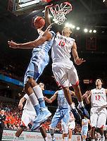 Virginia guard Malcolm Brogdon (15) defends North Carolina forward James Michael McAdoo (43) during an NCAA basketball game against Virginia Monday Jan. 20, 2014 in Charlottesville, VA. Virginia defeated North Carolina 76-61.