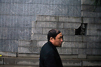 A man walks by a list of names of the victims of the Nanjing Massacre at the Memorial Hall of the Nanjing Massacre in Nanjing, Jiangsu, China on Dec. 13, 2009.  On Dec. 13, 2009, thousands of people visited The Memorial Hall of the Nanjing Massacre in Nanjing, Jiangsu, China, to remember those who died at the hands of Japanese soldiers in 1937-8.  The day marked the 72nd anniversary of the start of the massacre. The historical account has always been mired in controversy, and differing opinions on what actually happened have been a consistent obstacle to relations between China and Japan.  China's official account of history states that 300,000 people were killed by Japanese forces over a 6-week period starting Dec. 13, 1937