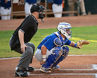 Austin Cowen (15) of the Ogden Raptors and home plate umpire Marc Lindsey behind the plate as the Raptors faced the Great Falls Voyagers at Lindquist Field on August 14, 2013 in Ogden Utah. (Stephen Smith/Four Seam Images)