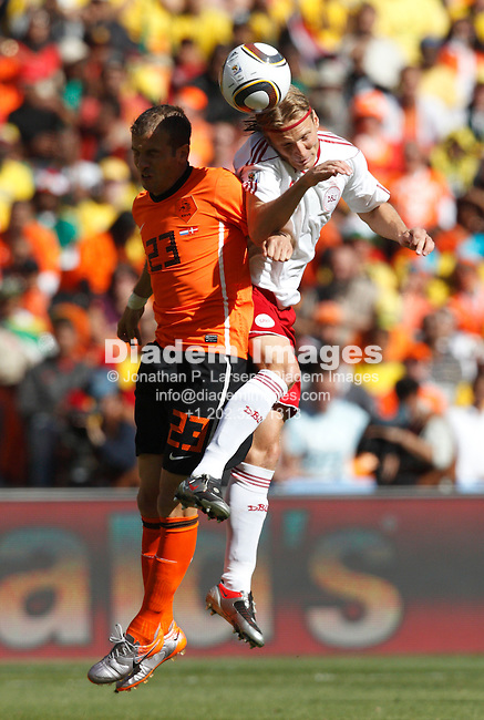 JOHANNESBURG - JUNE 14:  Rafael Van der Vaart of the Netherlands (l) and Christian Poulsen of Denmark (r) clash for a header during a 2010 FIFA World Cup soccer match June 14, 2010 in Johannesburg, South Africa.  NO mobile use.  Editorial ONLY.  (Photograph by Jonathan P. Larsen)