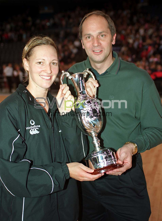 Pix: Ben Duffy/SWpix.com. International Netball. England v New Zealand. Test Series 2003. London Arena, Docklands London. 28/02/03..COPYRIGHT PICTURE>>SIMONWILKINSON>>01943 436649>>..New Zealand's Anna Rowberry is presented with the trophy by Sir Steve Redgrave.